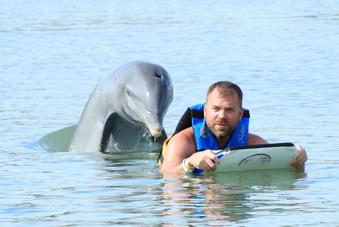 Image of Robert and a Dolphin