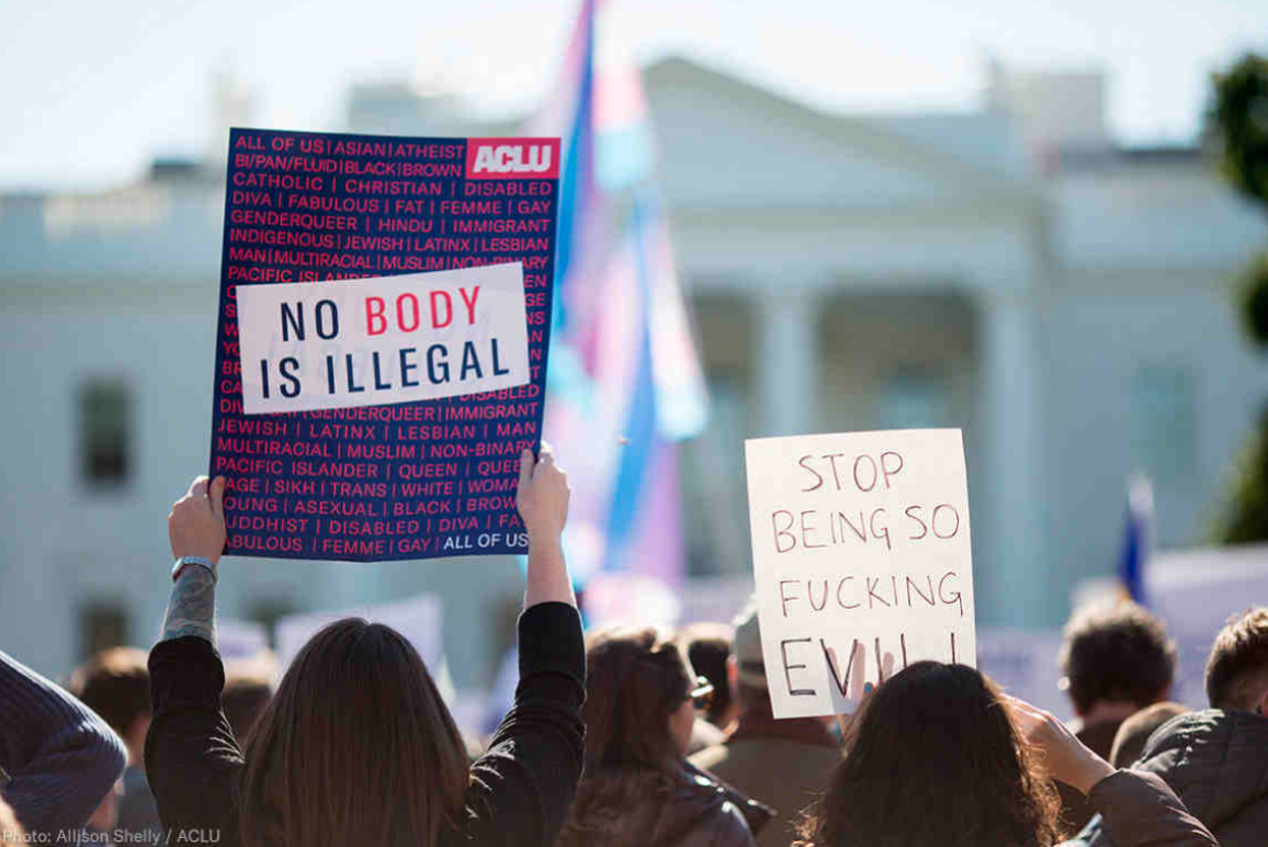 "Photo of a protest sign that says, ""No Body is Illegal"""