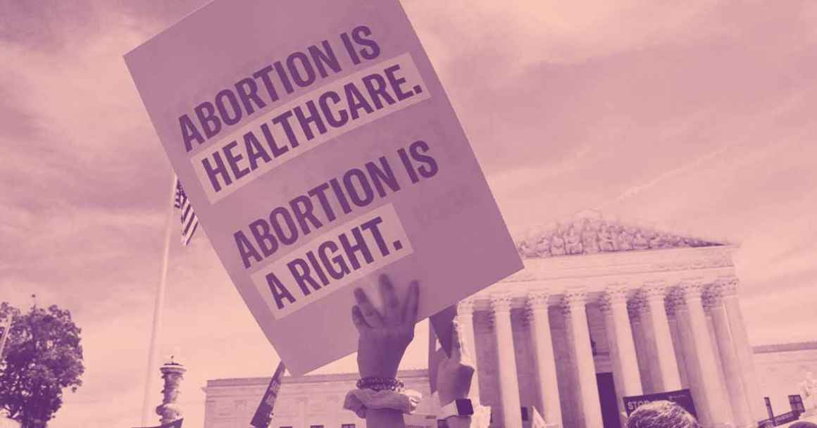 """Image of a protest sign that reads, """"ABORTION IS HEALTHCARE. ABORTION IS A RIGHT."""""""